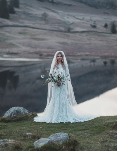 Bride in front of blea tarn in the lake district